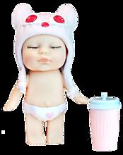 Куколка-сюрприз в упаковке в виде леденца на палочке