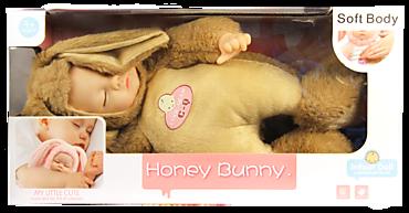 Спящий мальчик-зайчик в бежевой шубке, 40 см